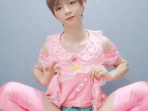 Japanese crossdresser masturbating in pinky banish dress