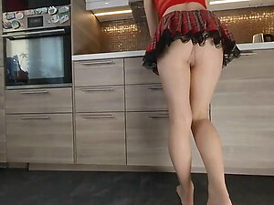 Beautiful Girl Cleaning Her Kitchen With Nude Pantyhose