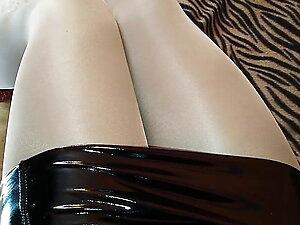 Satin tights, Red high heels and vinyl mini dress