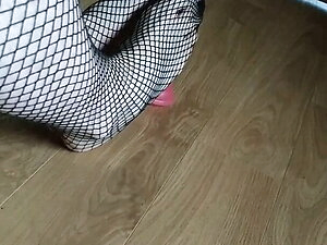 Cute little sissy trying to practice footjob in fishnets 2