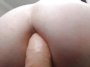 Bubble butt trans girl riding dildo