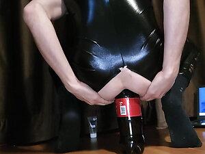 Tgirl try bottle in ass