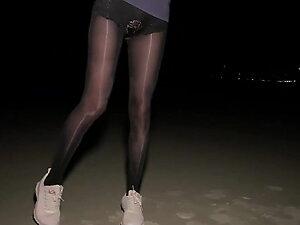 shiny black high waist pantyhose on night beach