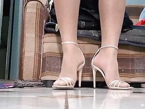 Tease in strappy heels