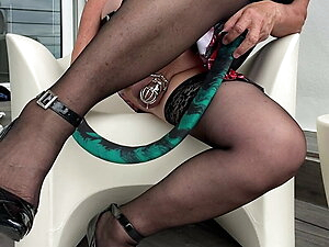Schoolgirl playing with her green snake