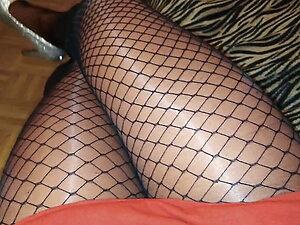 Fishnet tights, Red mini dress and silver glitter high heels